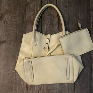 Hilifiger purse/ ripped but can be fixed